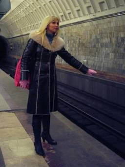 Blonde catches a ride in the subway